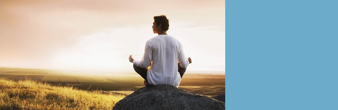Man-sitting-meditation-in-nature