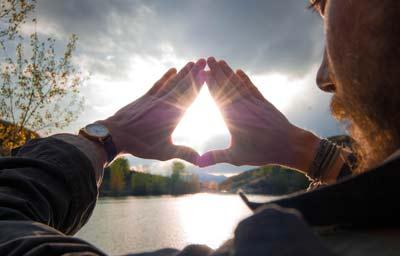 hands in akasha mudra with sunlight