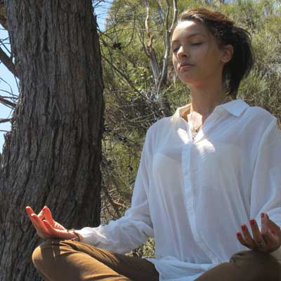 Radha meditating in nature